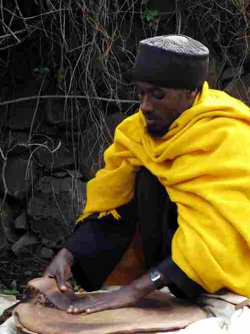 A priest is the only person allowed to prepare the bread that feeds the faithful at an ancient monastery on an island in Lake Tana, in the Ethiopian highlands. He distributes the bread after morning services.