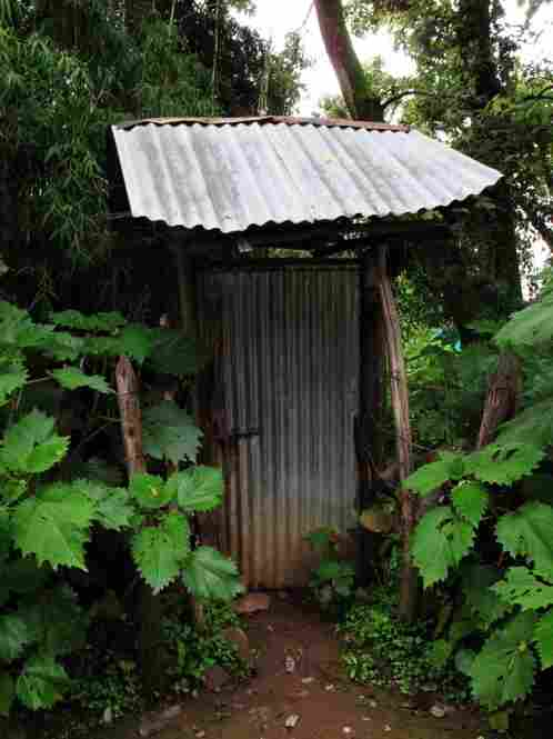 A locked door leads to a garden with a shack built over one of the springs.