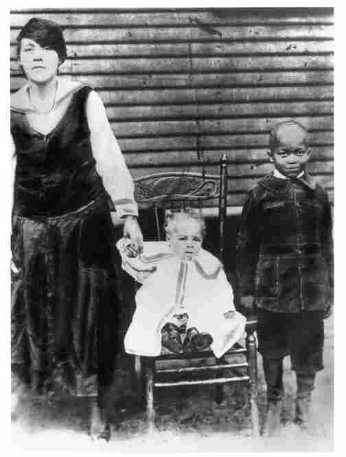 Norris' paternal grandmother, Frannie Norris, with her two eldest sons, Louis (seated) and Sylvester Wallace.