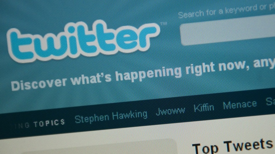 The Twitter homepage appears on a screen in Washington on Sept. 3. (AFP/Getty Images)