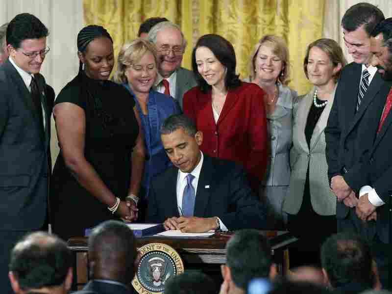 President Barack Obama signs the Small Business Jobs Act into law.