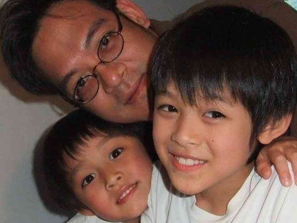 Vincent Young enjoys a moment with his two young sons.