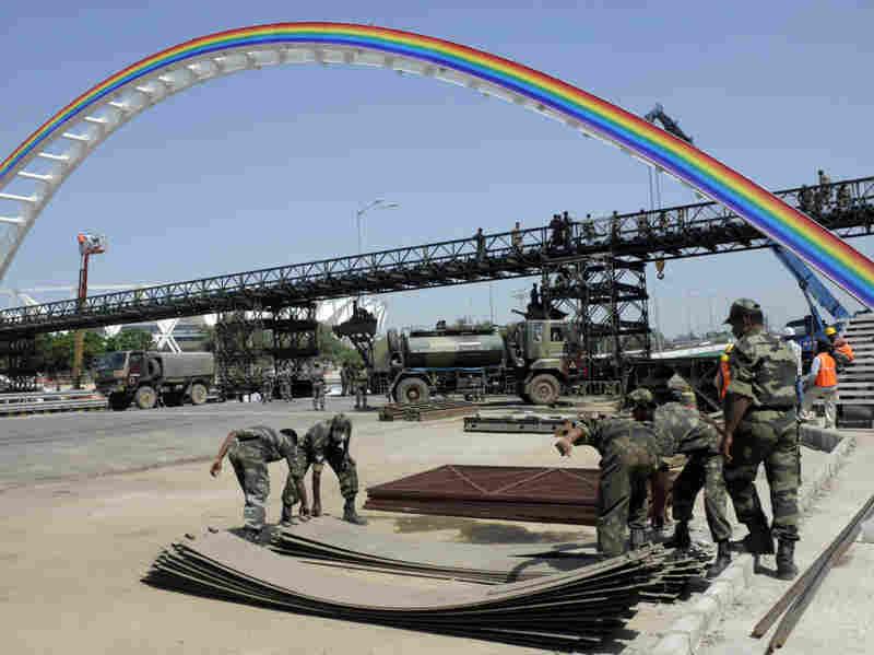 Indian soldiers rebuild a bridge