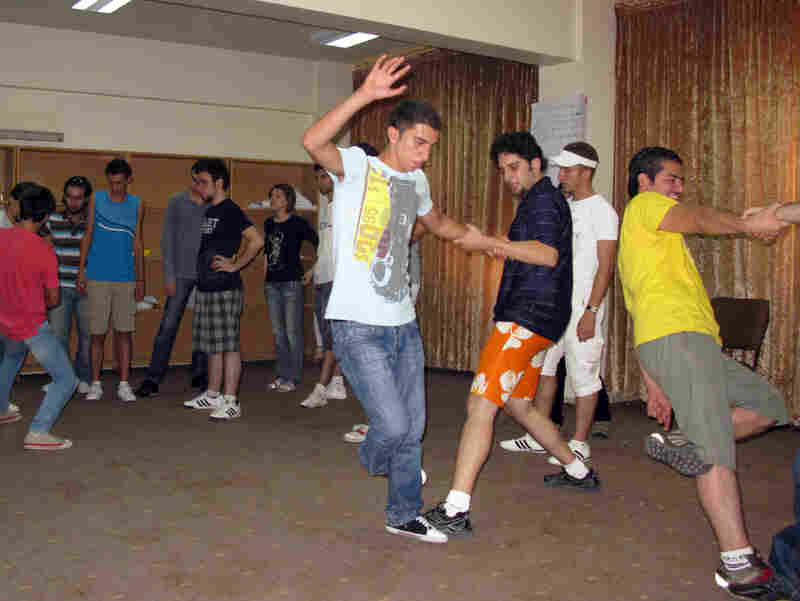 Syrian youths perform an exercise at the Syria Trust for Development in Damascus.