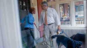 Sherry Shaffer and Alex Vila-Roger, with their dogs, outside the Pittsburgh home where they now live