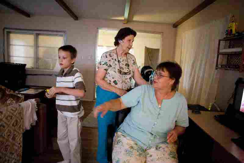 Rowena Suckow (right) lives in a double-wide trailer with with her 8-year-old son, Connor, who has Asperger's syndrome, and her mother, Willie Pate, 73. Suckow moved to Florida from North Carolina.