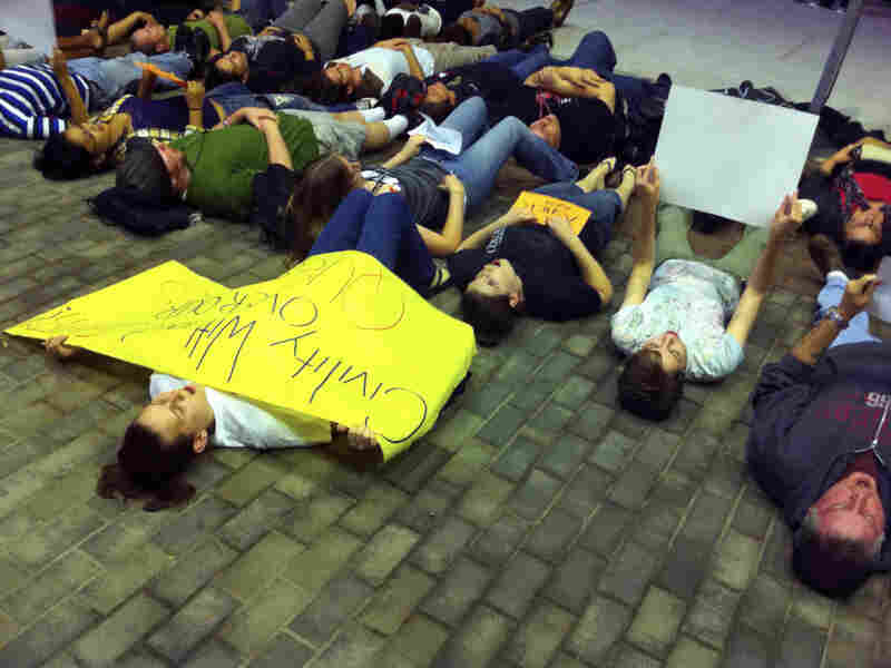 "Students participate in a ""lie-in"" at Rutgers University,"