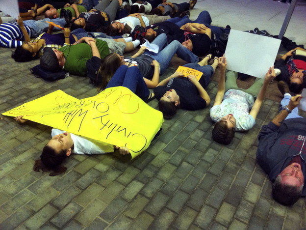 """Students participate in a """"lie-in"""" at Rutgers University, in New Brunswick, N.J., on Wednesday. The rally was in support of safe places for gay students."""
