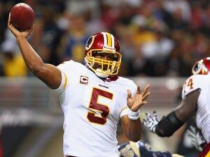 Donavan McNabb, quarterback for the Washington Redskins, passes against the St. Louis Rams