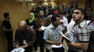 Iraqi journalists attend a press briefing in Baghdad in March 2010