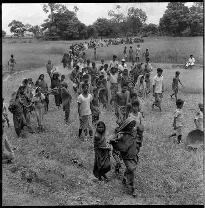 Refugees flee toward India through a subdistrict in East Pakistan's Comilla District (now Bangladesh), 1971