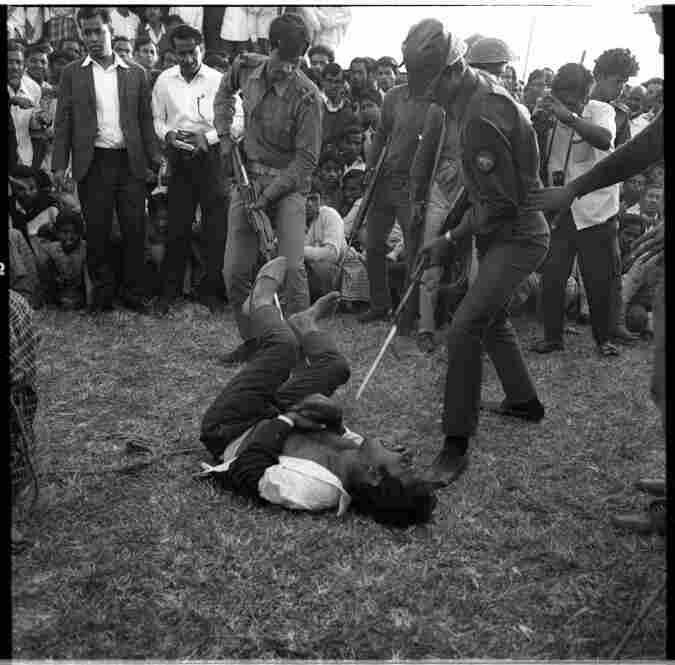 "Days after the Bangladesh Liberation War, Kaderia Bahini guerrillas (also called ""Kadar's Army"") publicly bayonet a Pakistani collaborator in Dhaka, Dec. 1971"