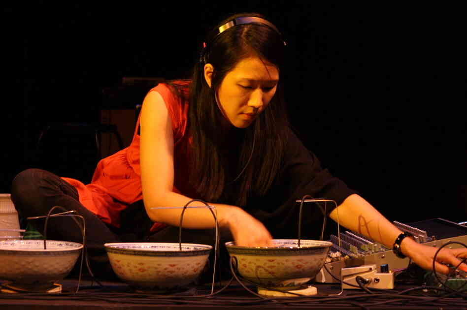 Tomoko Sauvage performs on porcelain bowls at the High Zero Festival.