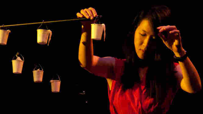 Tomoko Sauvage manipulates water droplets through effects pedals at the High Zero Festival.