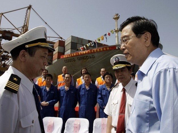 Chinese Vice-Premier Zhang Dejiang (right) talks to Cosco employees at the port of Piraeus near Athens in June. The Chinese company runs a major container port in Piraeus, but the prospect of more Chinese investment in the country is splitting Greeks.