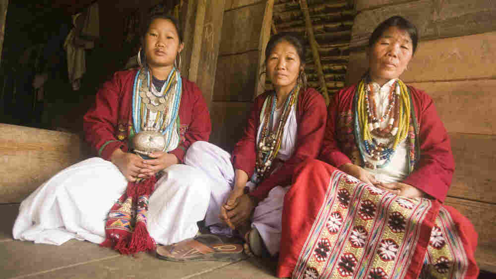 Three speakers of the newly identified language Koro  gather at a house in Kichang village in India.