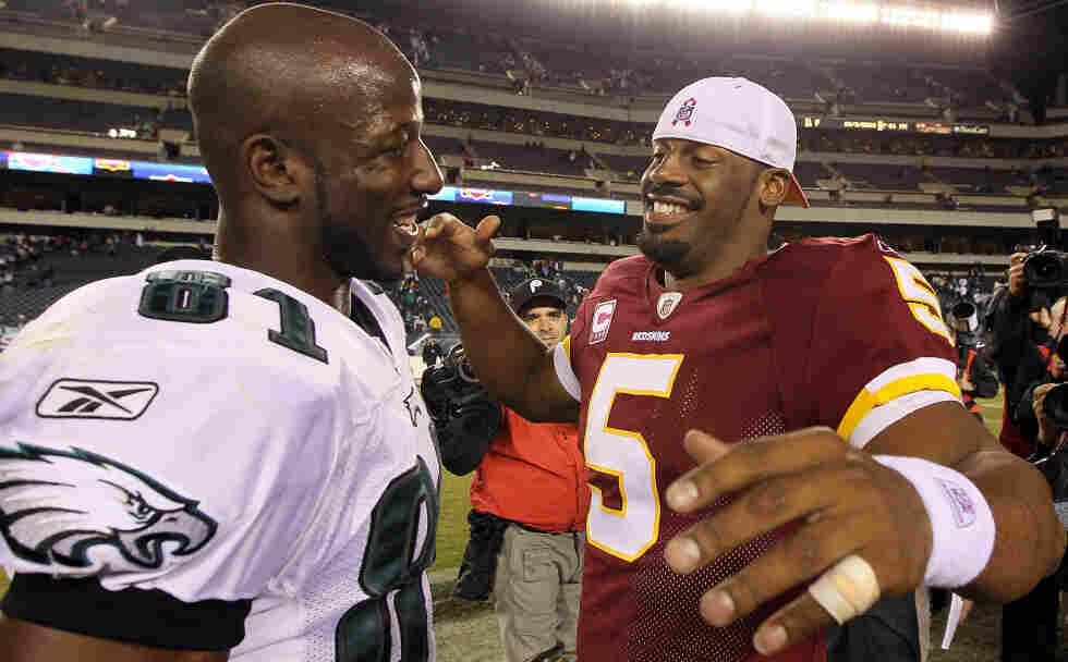 NFL player Donovan McNabb of the Washington Redskins greets Jason Avant of the Philadelphia Eagles.