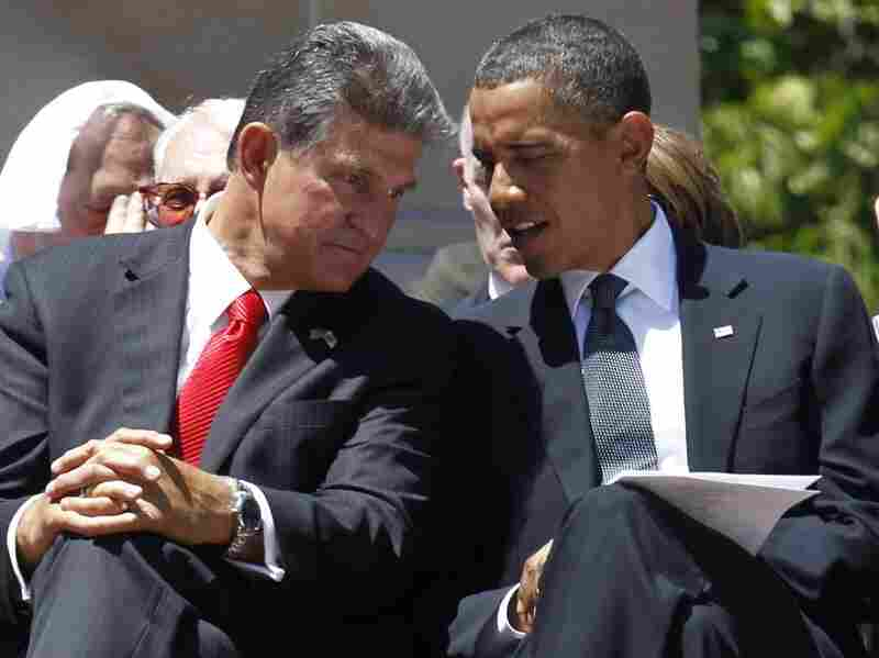 West Virginia Gov. Joe Manchin talks to President Obama at a memorial service for Sen. Robert Byrd.