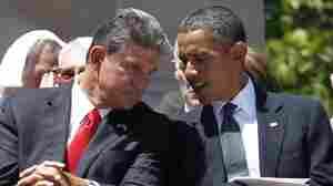 West Virginia Gov. Joe Manchin talks to President Obama at a memorial service for Sen. Robert Byrd.