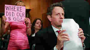 Sept. 10, 2009: A protester holds a sign as Treasury Secretary Timothy Geithner testifies about TARP