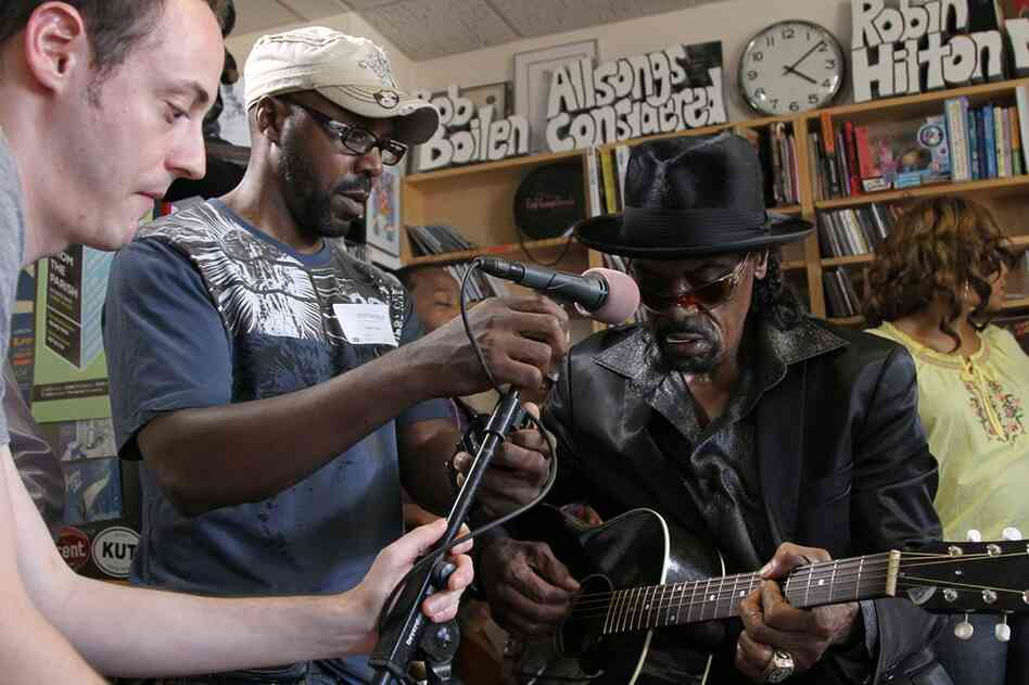 NPR's Michael Katzif (left) helps set up a microphone for Chuck Brown. September 15, 2010