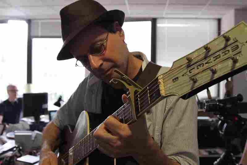 Bob Boilen picks up Basia Bulat's guitar before her Tiny Desk performance. September 27, 2010