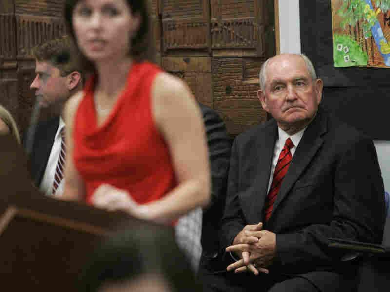 Georgia Gov. Sonny Perdue (right)