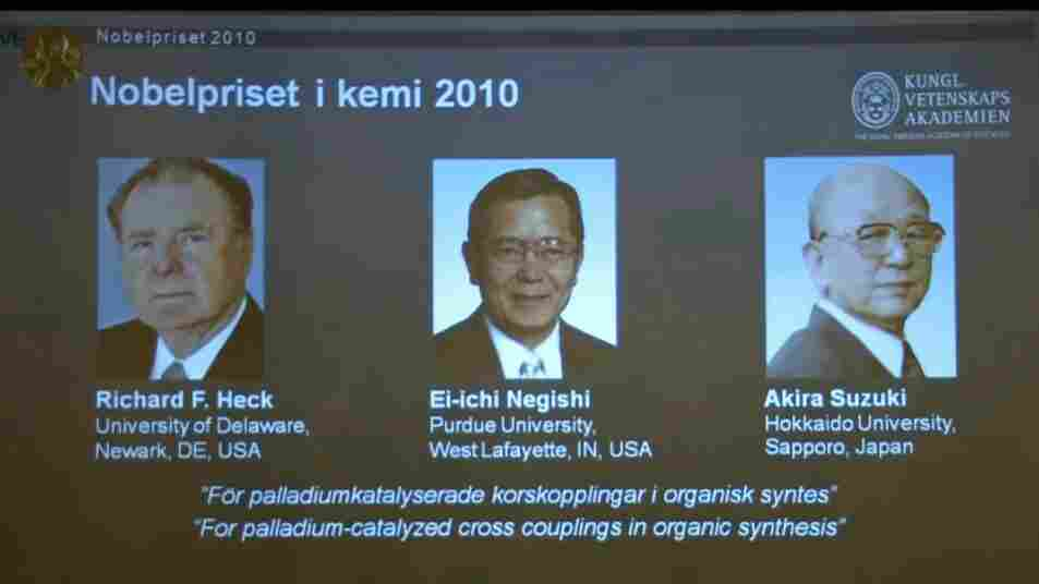 Nobel Chemistry Prize laureates Richard Heck, Ei-ichi Negishi and Akira Suzuki are shown on a televi