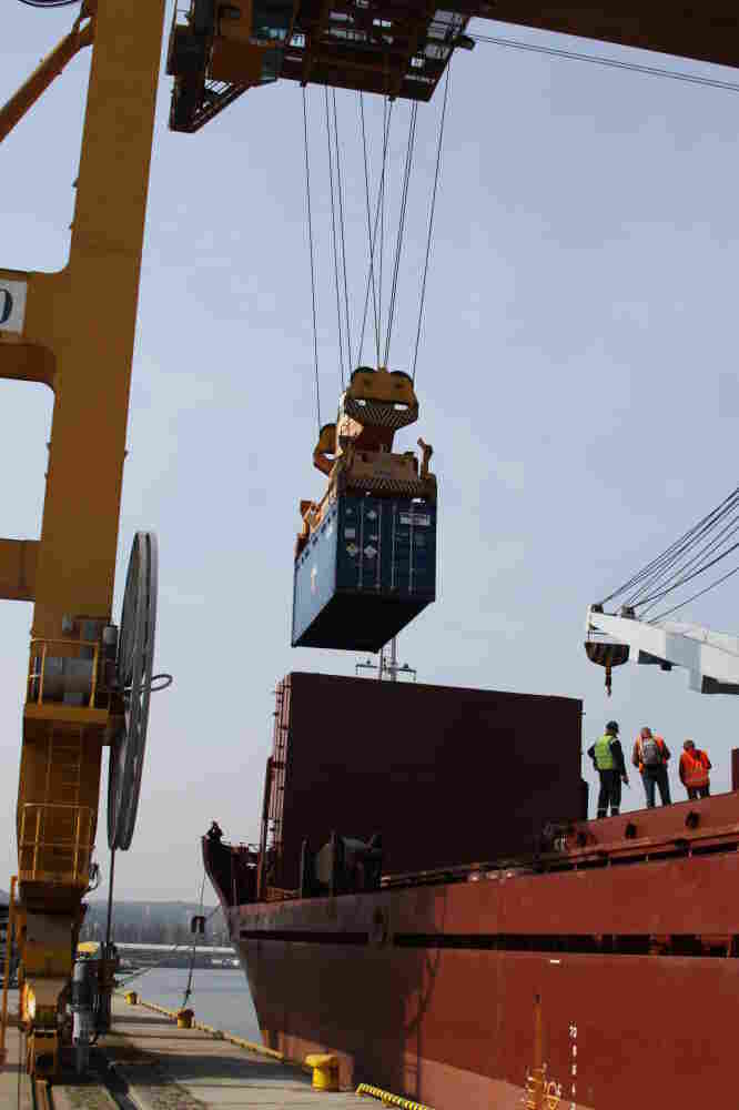 Containers of highly enriched uranium are loaded onto a boat in Gdynia, Poland