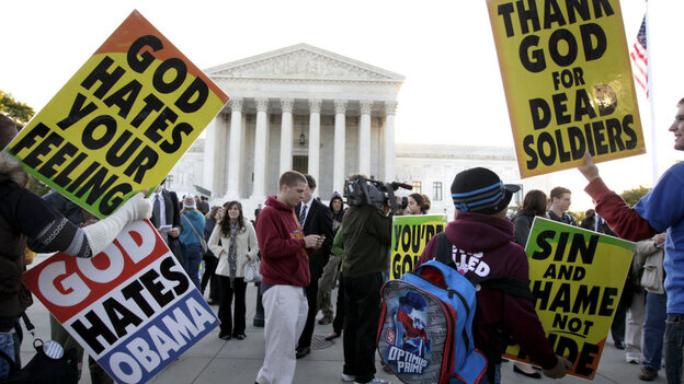 Members of the Westboro Baptist Church picket in front of the Supreme Court in Washington, D.C.