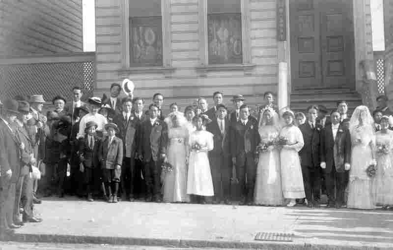 "Newly married Korean couples pose in front of the Korean Methodist Church on San Francisco's Bush Street (date unknown). Many of the Korean immigrants passing through Angel Island were ""picture brides,"" matched with Korean laborers working in the U.S. by matchmakers. Until 1917, picture brides were required to be remarried under U.S. law before being admitted to the country. (Courtesy of USC Ko..."