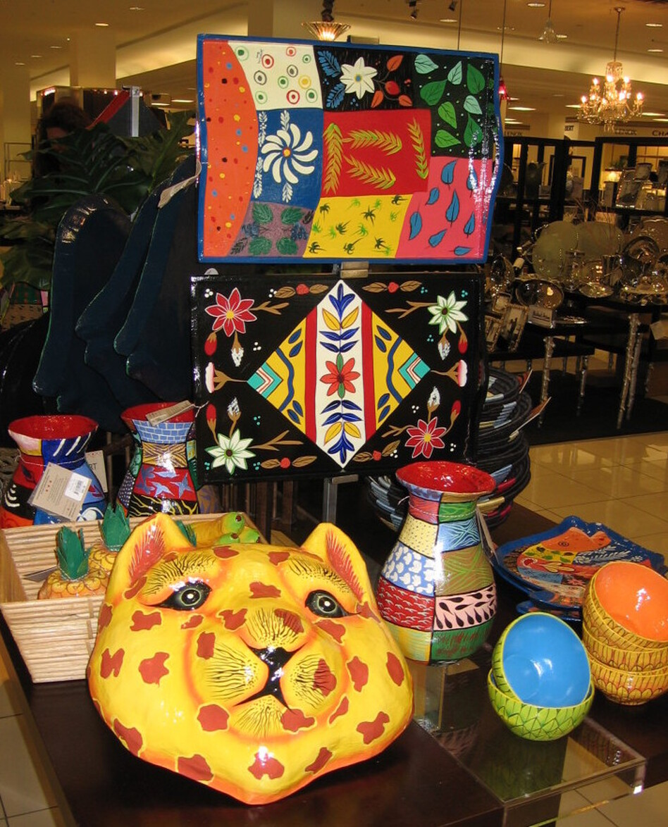 """The """"Heart of Haiti"""" collection, as shown in a display at Macy's in Miami, includes colorful trays, vases and other housewares — all created by Haitian artisans."""