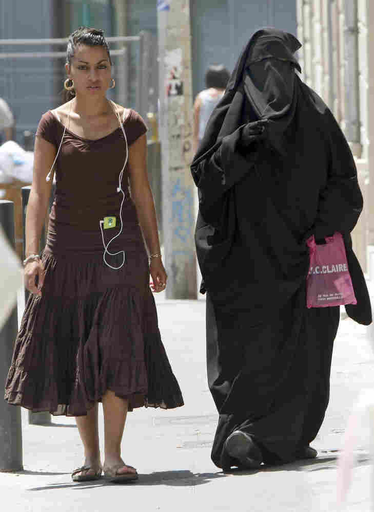 Two women, one wearing a  niqab, walk in Marseille, France. Claude Paris/AP