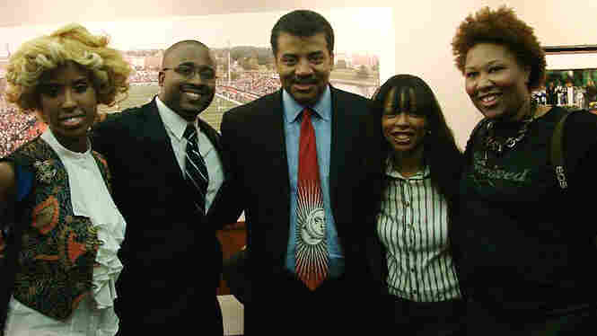 Writer Jamila Bey poses with others at an event for skeptics at Howard University.