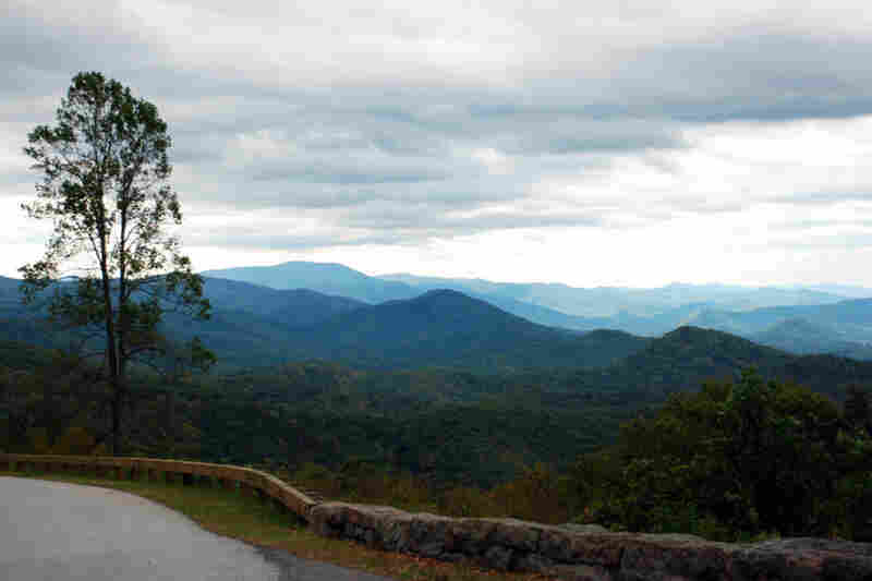 The Blue Ridge Parkway is a 469-mile road that stretches from the southern end of Shenandoah National Park in Virginia to the Great Smoky Mountains in North Carolina.
