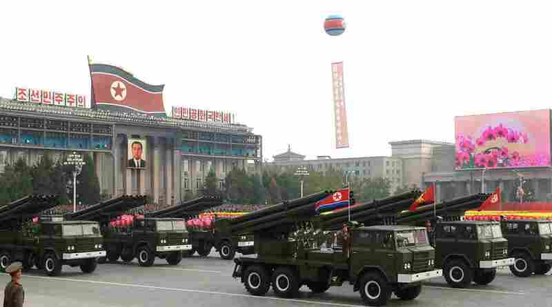"Trucks loaded with rocket launchers rolled past, but they were dwarfed by a series of missiles, each larger than the last and emblazoned with the words ""Defeat the U.S. military. U.S. soldiers are the Korean People's Army's enemy."""