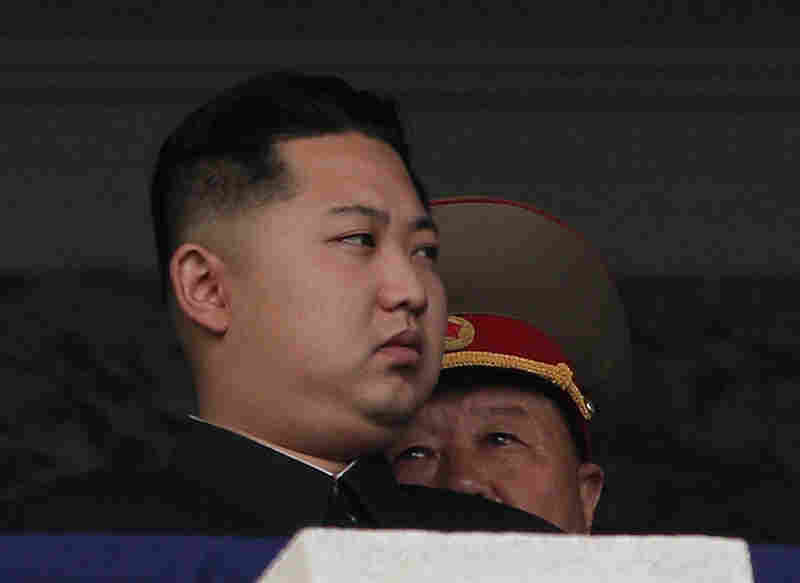 Kim Jong Un sat on an observation platform at Kim Il Sung Plaza as armored trucks with rocket launchers and tanks roll by, part of celebrations marking the 65th anniversary of the reclusive state's ruling Workers' Party.