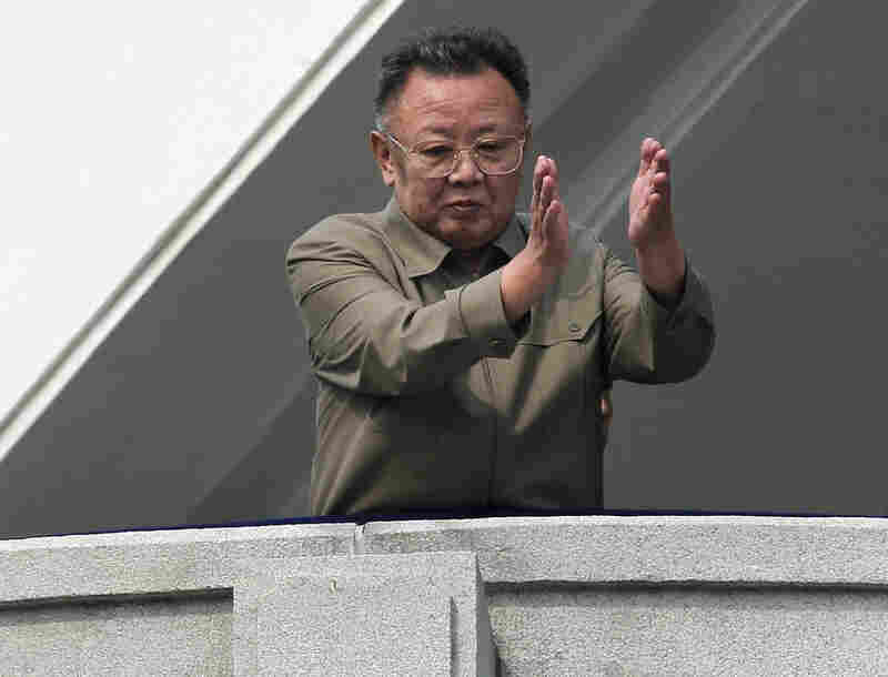 """Kim Jong Il! Protect him to the death!"" ""Kim Jong Il, let's unite to support him!"" spectators chanted as the 68-year-old leader walked the length of the platform, appearing to limp slightly and gripping onto the banister."