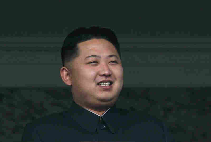 Clapping, waving and even cracking a smile, the youngest son of North Korean leader Kim Jong Il joined his father Sunday at a massive military parade in his most public appearance since being unveiled as the nation's next leader.