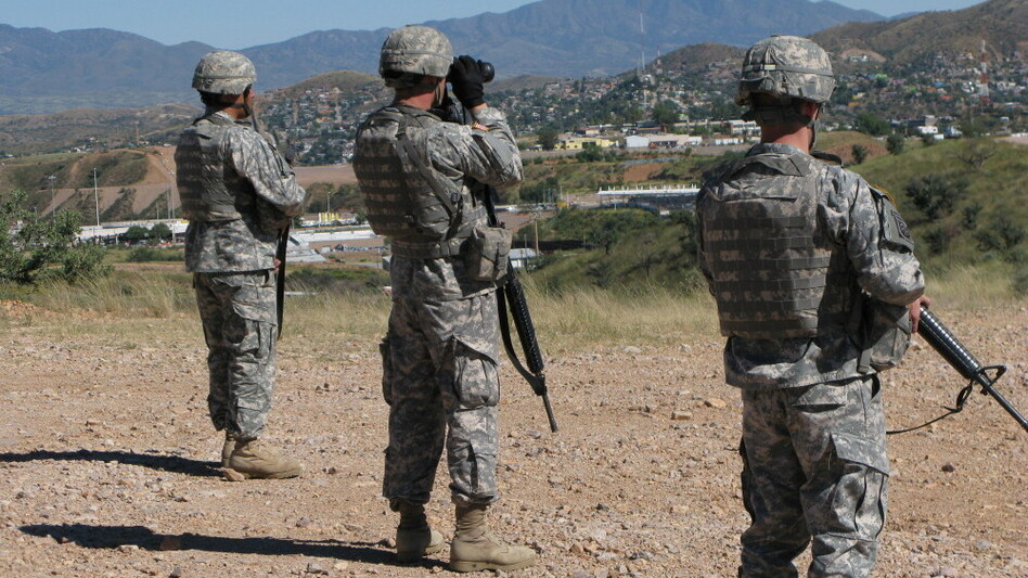 National Guard soldiers stand watch near Nogales, Ariz., over the border with Mexico. President Obama deployed 1,200 troops to the border states in July, nearly half in Arizona. The state is the busiest in the nation for illegal border crossings.