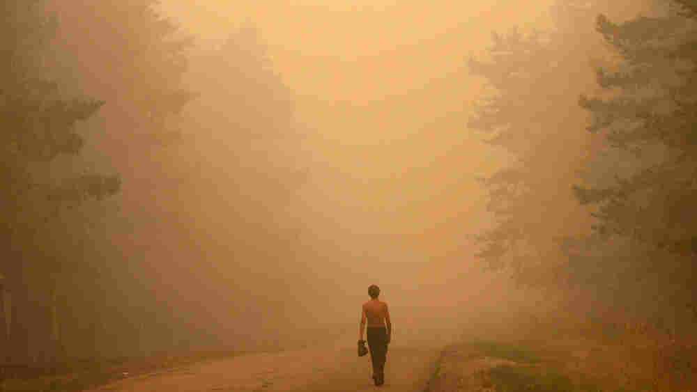 A Russian man walks along the road 130 kilometers outside Moscow