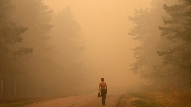 A Russian man walks along the road 130 kilometers outside Moscow