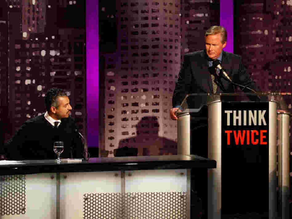 Maajid Nawaz (left) with moderator John Donvan of ABC News at an Intelligence Squared U.S. debate.