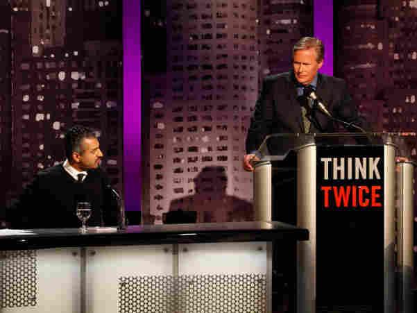 Maajid Nawaz (left) with moderator John Donvan of ABC News at an Intelligence Squared U.S. debate.