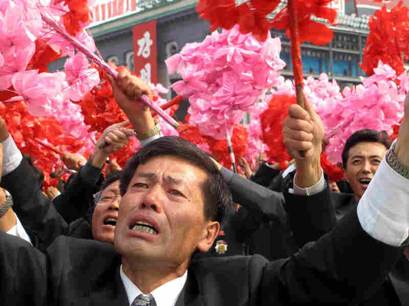 The faithful weep with joy at a rally for their leader, Kim Jong Il, and his son and chosen successor, Kim Jong Un.