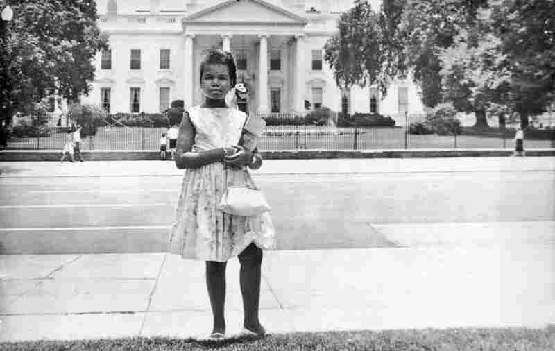 Condoleezza Rice stands in front of the White House as a girl.
