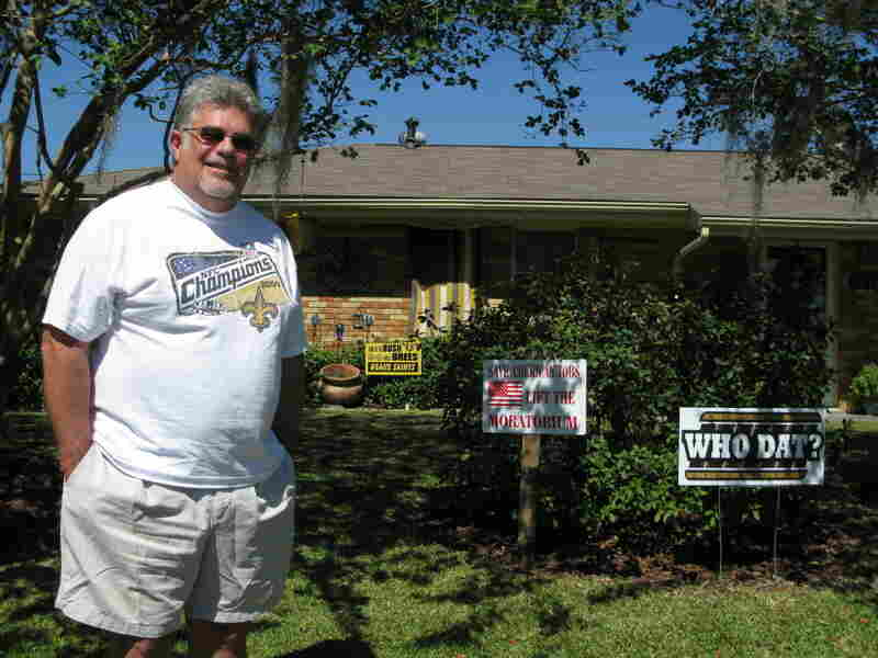 Ken Tanguis stands outside his home in Houma, La.