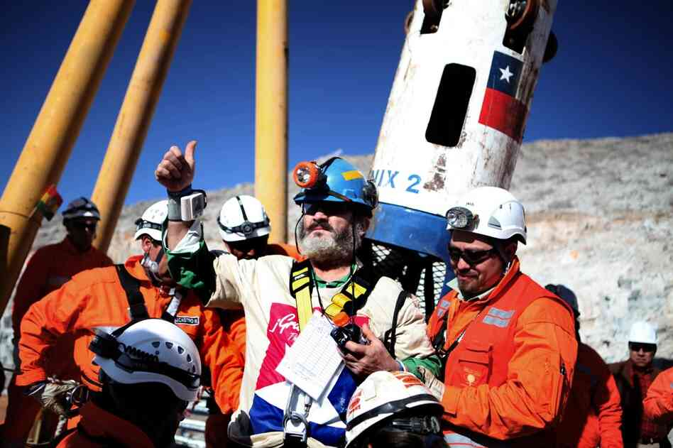 Jorge Galleguillos gives the thumbs up upon surfacing from the mine. The entire operation was meticulously choreographed, with no expense spared in bringing in topflight drillers and equipment — and drilling three s