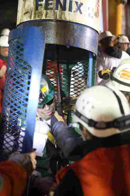 """Miner Jose Ojeda gets out of the he missile-like """"Phoenix"""" rescue capsule."""