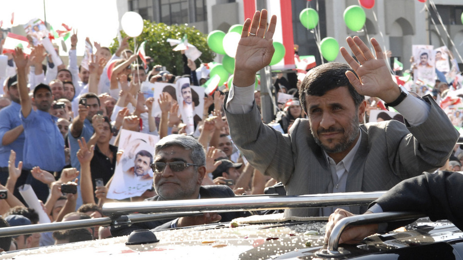 Iranian President Mahmoud Ahmadinejad waves to the crowds from the sunroof of his SUV upon his arrival in Beirut on Wednesday. Thousands of cheering Lebanese welcomed Ahmadinejad to Lebanon, throwing rose petals and sweets at his motorcade at the start of a visit that underscores a growing recognition of Iran as a power broker in the region.